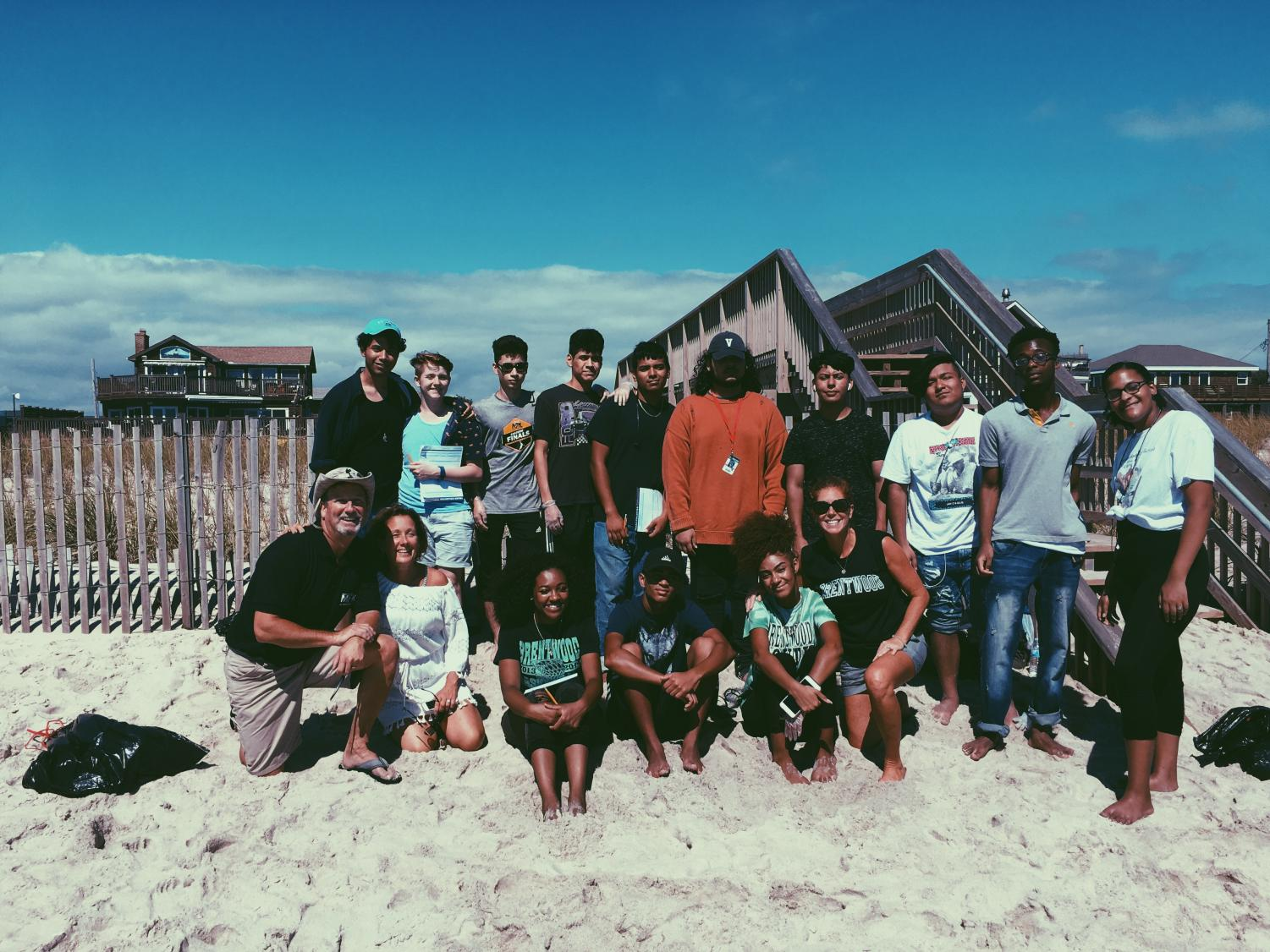 Eleven students and their teacher participate in an Ocean Beach clean up.