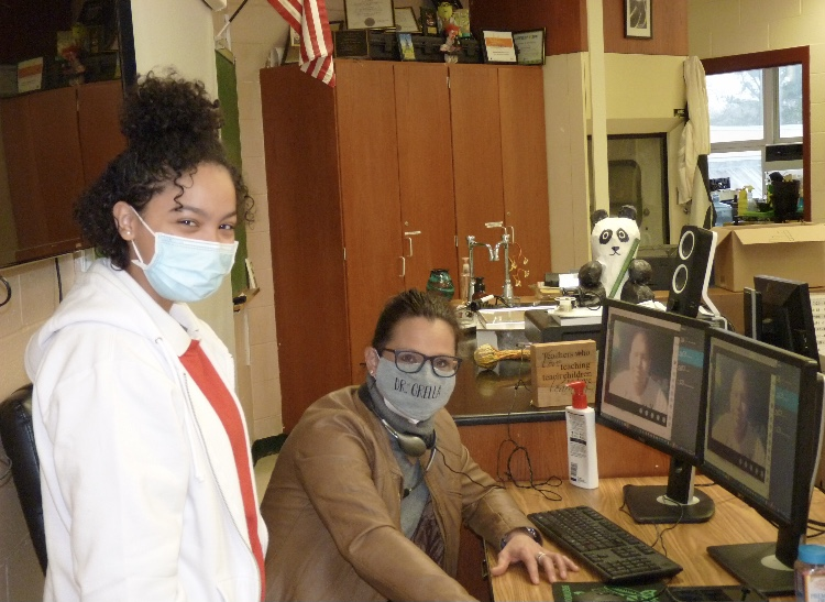 Dr. Grella poses with one of her science research students.
