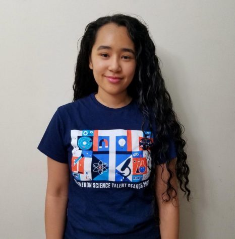 Ashley Alcantara, a Regeneron Semi-Finalist as of Thursday, Jan. 7, poses in her 2021 Regeneron competition T-shirt.