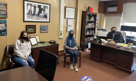 Nabihah Ahsan and Julia Spadaro, both seniors, interview Principal Callan in his office.