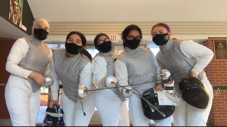 The members of the girls Varsity Fencing Team pose with their sabers.